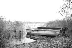 Old fishing boats. On a lake`s shore Royalty Free Stock Image