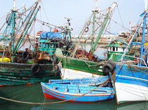 Old fishing boats and motor-boats in the harbor of Agadir Stock Photos