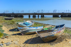 Old fishing boats on the shore of a river Royalty Free Stock Photo