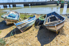 Old fishing boats on the shore of a river Stock Photography