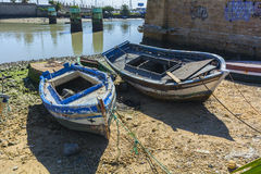 Old fishing boats on the shore of a river Stock Photo