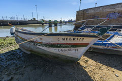 Old fishing boats on the shore of a river Stock Image