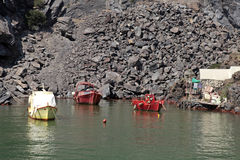 Old fishing boats in small bay on small volcanic island, Santori Royalty Free Stock Images
