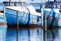 Old fishing boats in small port of Fur. Old blue fishing boats in small port of island Fur Royalty Free Stock Photos