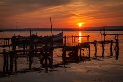 Old fishing boats at sunset on Varna Lake Royalty Free Stock Image