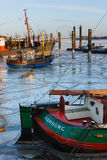 Old fishing boats  in winter on Elbe river. Royalty Free Stock Image