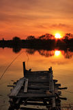 Old fishing bridge on the lake. At sunset Royalty Free Stock Photo