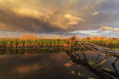 Old fishing bridge at sunset Stock Photos