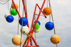 Old fishing buoy  hanging with chain Royalty Free Stock Photo
