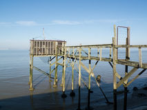 Old fishing cabin and carrelet net Royalty Free Stock Photo