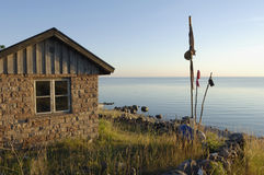 Old fishing cabin and sea Royalty Free Stock Images