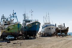 Old fishing in dry dock. Fishing boat in the sea port in the old slip dock Royalty Free Stock Photo