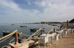 The old fishing harbor of Houmt Souk. View over the old fishing harbor of Houmt Souk/Djerba/Tunisia with the fort Bordj el kebir in the background Stock Image