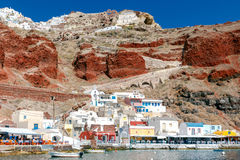 The old fishing harbor in the village Oia. Royalty Free Stock Images