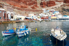 The old fishing harbor in the village Oia. Royalty Free Stock Photo