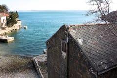 Old fishing house on the Adriatic Sea coast in lagoon. Croatia Harbor stock image