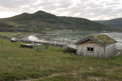 Old fishing hut on the beach Stock Photography