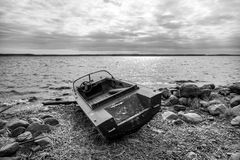 Old fishing motor boat on lake coast Royalty Free Stock Image