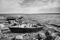 Old fishing motor boat on lake coast Royalty Free Stock Images