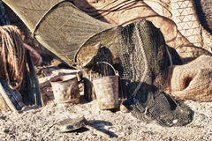 Old fishing net. An old fishing net hanging on rustic stone wall royalty free stock photos