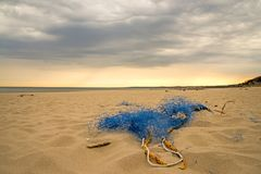 Old fishing net on a beach. Of the Baltic sea in Poland royalty free stock photos