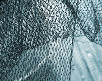 Old fishing net blue background Royalty Free Stock Photography
