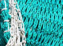 Old fishing net. Waiting in the docks - Selective focus royalty free stock photo
