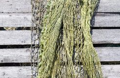 Old fishing net. Waiting in the docks - Selective focus royalty free stock photos