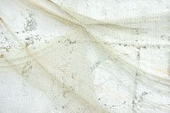 Old Fishing Net on White Wall Royalty Free Stock Image