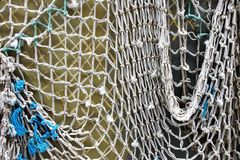 Old Fishing Net on White Wall Royalty Free Stock Images
