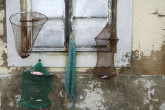 Old fishing nets hanging on a window Stock Image