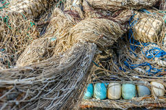 Old fishing nets. Heap of old fishing nets with floats close-up Royalty Free Stock Images