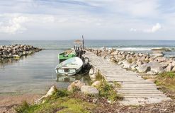 Old fishing oar boats in sea attached to bridge Stock Image