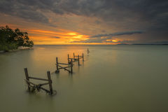 Old Fishing Pier during sunset at fishing village in Malaysia Stock Image