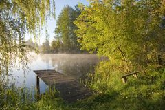 Old fishing platform. By pond bank royalty free stock photography