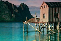 Old fishing port by fjord Stock Photography