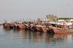 Old fishing port in Kuwait City. Traditional wooden dhows in the fishing port of Kuwait, Middle East stock photo