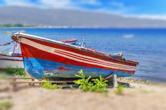 Old fishing red and blue boat tied on dock Royalty Free Stock Photos