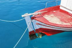 Old fishing red boat tied on dock Royalty Free Stock Images