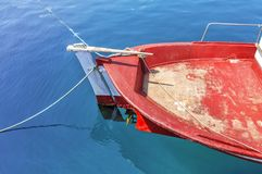 Old fishing red boat tied on dock. Close Stock Image