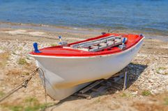 Old fishing red and white boat tied on dock. Close Royalty Free Stock Image