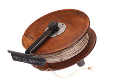 Old fishing reel of wood. Stock Photography