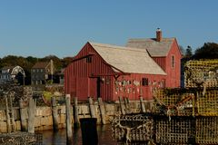 Old Fishing Shack  Motif Number One with lobster traps. Motif #1, old red fishing shack in rockport massachusetts, world famous spot for artists and Royalty Free Stock Images