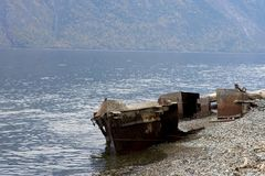 Old fishing vessel on the lake coast royalty free stock photo