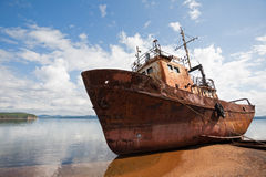 Old fishing vessel on the sea coast Stock Photo
