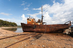 Old fishing vessel in the seaport. Fishing boat in the sea port in the old slip dock Stock Images