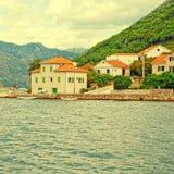 Old fishing village with pier , Kotor Bay, Montenegro. Royalty Free Stock Photos