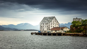 An old fishing warehouse on the ocean Stock Photography