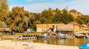 Old dock for fishing boats stock photo
