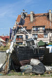 Old fishingboat on land Stock Photos